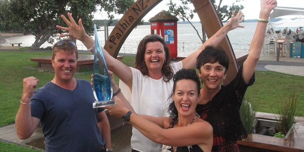 TOP TOWN: Celebrating Paihia's new status as Community of the Year last week were Grant Harnish (left), Tania McInnes, Tiffany Holland (with the trophy) and Anne Corbett.