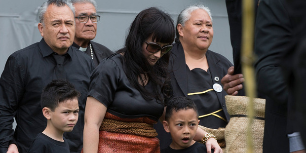 Jonah Lomu's wife Nadene Lomu with sons Dhyreille and Brayley are supported by her parents at Eden Park. Photo / Brett Phibbs