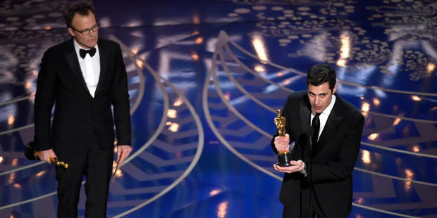 Tom McCarthy and Josh Singer accept the award for best original screenplay for Spotlight at the Oscars. Photo / AP
