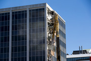 The 85-tonne excavator at work on the demolition of 61 Molesworth Street in Wellington. New Zealand Herald photograph by Mark Mitchell.