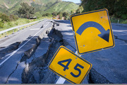SH1 toward Kaikoura from the south is a wild ride over cracked seal and gaping holes caused by last month's quake. Photo / Mike Scott.