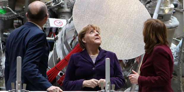 German Chancellor Angela Merkel visit the site of the new Wendelstein 7-X nuclear fusion experiment. Photo / Getty