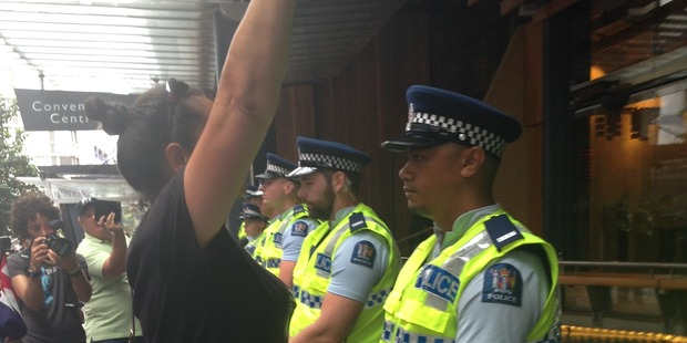 Police formed ranks around the entrance to SkyCity. Photo / Catherine Gaffaney
