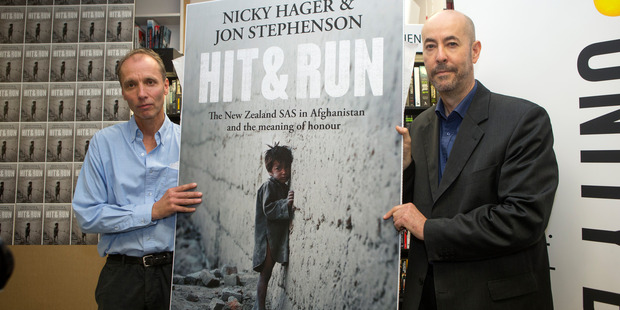 Authors Nicky Hager, left, and Jon Stephenson with their book, Hit & Run during the launch at Unity Books in Wellington. Photo / Mark Mitchell