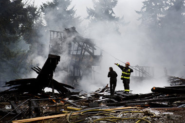 """Vancouver, Washington--October 12, 2012--Fire crews and agents from the ATF and FBI remain on the scene of a large overnight fire that destroyed a Sikh Temple in Vancouver. The blaze was reported shortly after 2:25 a.m. Ross William Hamilton/The Oregonian"" (source: The Oregonian)"