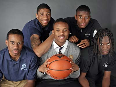 The Daily News Player of the Year Maalik Wayns, of Roman Catholic, holds the ball surrounded by other first-teamers (from left) Denzel Yard, of Franklin Learning Center; Jesse Morgan, of Olney; Sam Prescott, of Imhotep Charter; and Tyrone Garland, of John Bartram. (Steven M. Falk / Staff photographer)