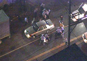 Footage from a news helicopter shows Philadelphia Police officers beating three suspects on North 2nd Street near Lippincott in Hunting Park late Monday night.