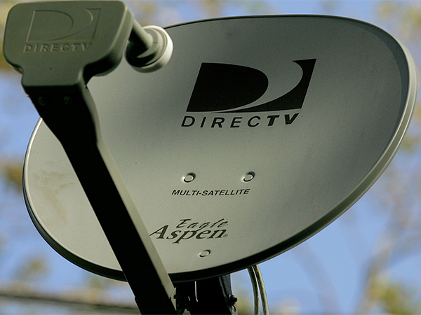 "AT&T said it was offering $95 per DirecTV share in a combination of stock and cash, with the cash portion financed by cash, asset sales, financing already lined up and other ""opportunistic debt market transactions."" (FILE)"