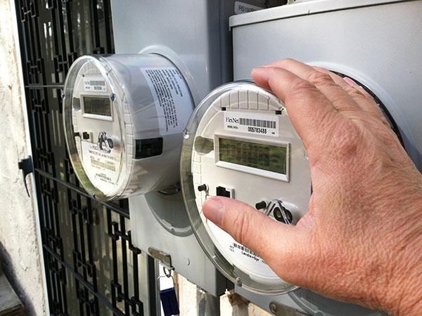 Smart meters on a house in Delaware County. (Reid Kanaley / Staff)<br />