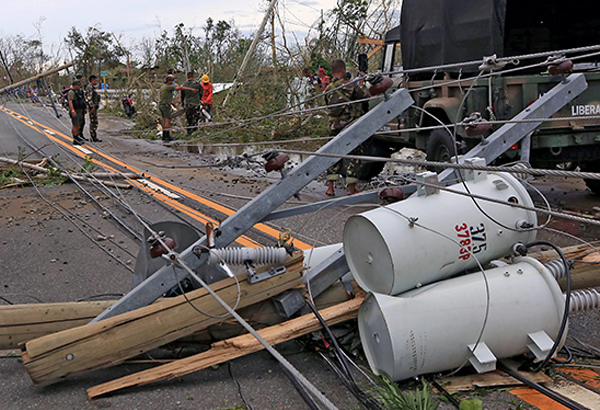 Damaged power lines along the Maharlika Highway leading to Tuguegarao City