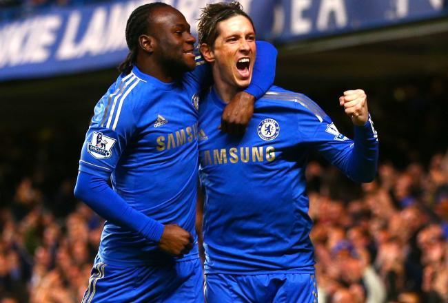Fernando Torres celebrates his goal with teammate Victor Moses
