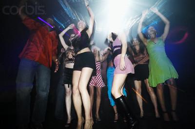 women and men dancing in a club