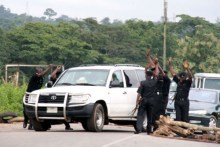 Nigerian police at a checkpoint used to illustrate the story