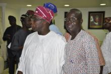 Obasanjo with Premium Times Journalist over the smashed Black Berry Phone