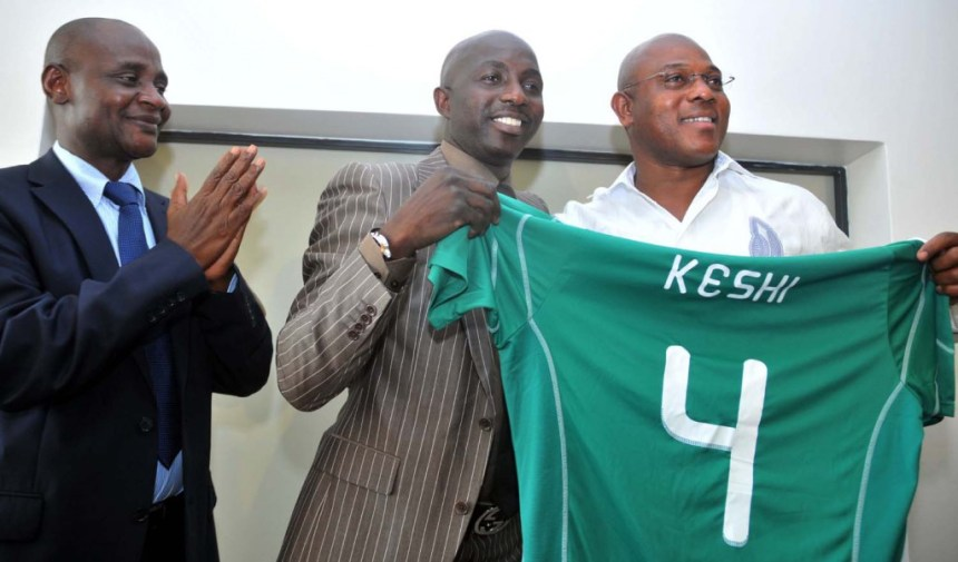 FILE PHOTO: Stephen Keshi holding the No. 4 jersey.