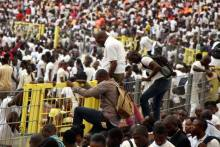 FILE PHOTO: Surging crowd at an Immigration recruitment test in 2014.