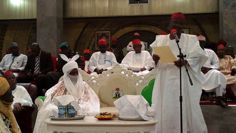 Gov. Rabi'u Musa Kwankwaso of Kano state reading the of appointment to the hearing of the public before he formally presented it to the new Emir of Kano, His Highness Sanusi Lamido Sanusi at Africa House, Government House, Kano, today, Monday. Photo: Govt. House, Kano. 9/6/2014