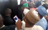 Tambuwal and his Deputy Ihedioha shielded by members and NASS staff.