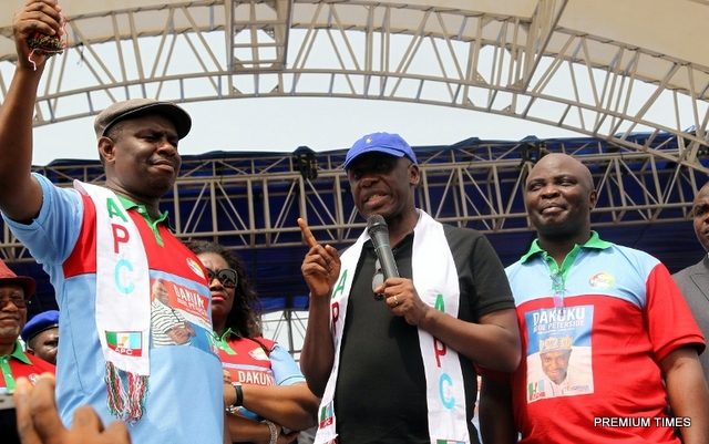 FILE: Former Rivers State Governor, Chibuike Rotimi Amaechi flanked by the All Progressives Congress Governorship Candidate in the State, Dakuku Peterside (left) and his running mate, Asita, at the State APC 2015 gubernatorial campaign flag off at the Liberation Stadium, Port Harcourt.)