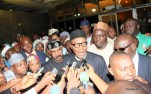 Muhammadu Buhari answering questions from journalist at the Airport