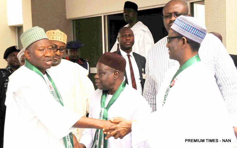 FILE PHOTO: President Goodluck Jonathan in a handshake with the PDP Governorship candidate Mallam Nuhu RIbadu at the PDP Stakeholders meeting