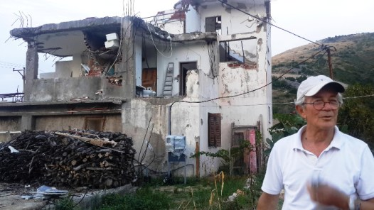 Albanian authorities used a World Bank-backed project to clear the way for a planned seaside resort, partly or completely tearing down 15 homes in the impoverished village of Jale. Andon Koka's home was flattened, and half of his brother's home (in background) was demolished. Besar Likmeta / BalkanInsight.com