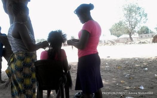 Young IDPs in Waru earn a living making hairs.