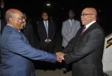 Sudan President, Omar Al-Bashir in handshake with South African President, Jacob Zuma