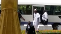 Abdulaziz Nyako stepping down from the bus that brought them to court
