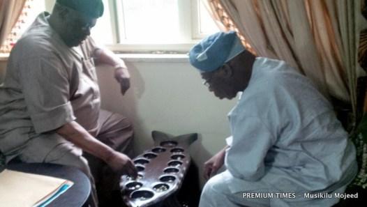 Former president, Olusegun Obasanjo, playing Ayo with friend