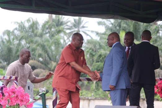Rivers State Governor, Nyesom Wike (right) in a handshake with the General Overseer of Lord's Chosen Charismatic Revival Mission Church, Pastor Mouka Lazarus during their church programme in Port Harcourt.