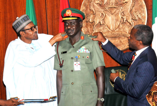 President Muhammadu Buhari (L)  Aided By Vice-President Yemi Osinbajo In Decorating  The Chief Of Army Staff, Maj.-Gen. Tukur  Buratai With His New Rank Of  Lt.-Gen,  At The  Presidential Villa Abuja On Thursday (13/8/15) | NAN