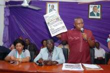 NUJ Chairman, Akwa Ibom State, Patrick Albert, displaying a copy of the controversial Global Concord edition during an emergency meeting of publishers and editors in the state.
