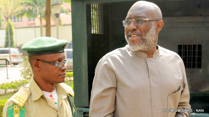 The National Publicity Secretary of PDP, Mr Oilsa Metuh, at the Federal  High Court, where he is standing trial over alleged N400m fraud, in Abuja
