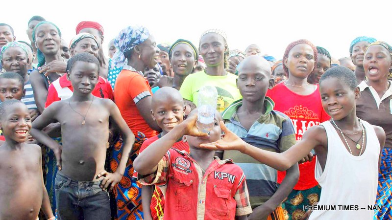 PIC.5. A BOY DRINKING WATER  THAT WAS TREATED BY THE WIFE OF THE   FORMER SENATE PRESIDENT, MRS HELEN MARK,  DURING HER VISIT TO AILA IDPS CAMP TO DONATE  RELIEF   MATERIALS, AS PART OF ACTIVITIES TO MARK FORMER SENATE PRESIDENT'S 68TH BIRTHDAY  IN AILLA   COMMUNITY, AGATU, BENUE ON SUNDAY(10/4/16). 2845/10/4/2016/HB/JAUNAN