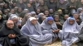 """A screengrab taken on May 12, 2014, from a video of Nigerian Islamist extremist group Boko Haram obtained by AFP shows girls, wearing the full-length hijab and praying in an undisclosed rural location. Boko Haram released a new video on claiming to show the missing Nigerian schoolgirls, alleging they had converted to Islam and would not be released until all militant prisoners were freed. A total of 276 girls were abducted on April 14 from the northeastern town of Chibok, in Borno state, which has a sizeable Christian community. Some 223 are still missing. AFP PHOTO / BOKO HARAM RESTRICTED TO EDITORIAL USE - MANDATORY CREDIT """"AFP PHOTO / BOKO HARAM"""" - NO MARKETING NO ADVERTISING CAMPAIGNS - DISTRIBUTED AS A SERVICE TO CLIENTS"""