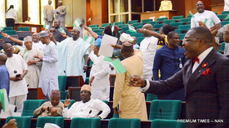 FILE PHOTO: Some Members of the House of Representatives protesting  'Removal of Fuel Subsidy' during a special House Session on the deregulation at the National Assembly in Abuja