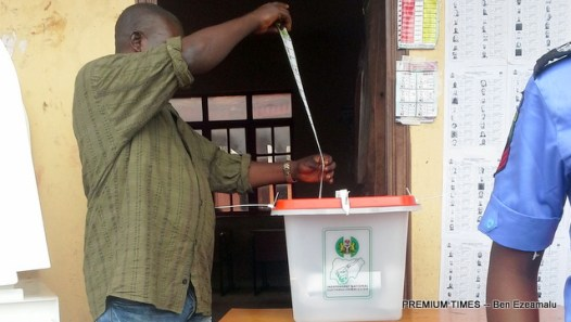 A voter casting his vote at the Edo election