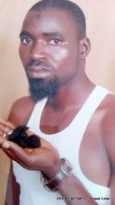 Abdullahi Ibrahim with his shaved beard in his hand