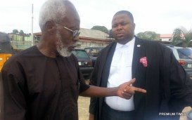 Inih Ebong  explaining some point to a sympathetic lawyer outside the courtroom. Photo credit.: CletusUkpong