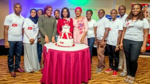 Ace Charity Founder Kiki James with some Directors and also a cross section of volounteers cutting the Ace Charity Anniversary cake at their Annual Fundraising Dinner in Abuja