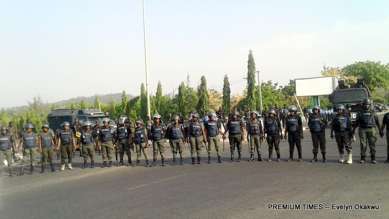Members of the Bring Back Our Girls group being stopped by a cordon of police officers at the three-arm zone, Abuja.