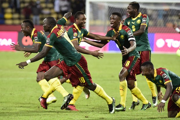 Cameroon's players celebrate as Vincent Aboubakar scores the winning penalty. Photograph: Khaled Desouki/AFP/Getty Images