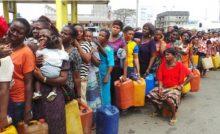 Nigerians in a tight queue to buy Kerosene