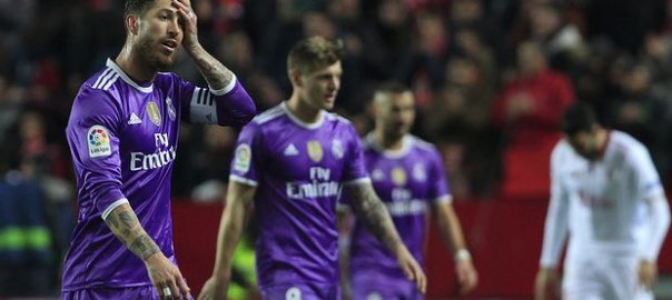 Sergio Ramos, left, has made a habit of scoring late and decisive headers but did so into his net against his former club Sevilla on Sunday. Photograph: Angel Fernandez/AP