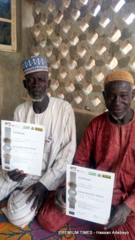 Alhaji Shehe displaying certificate of participation in an ABP training programme