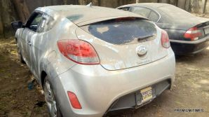 Some of the cars recovered by the EFCC warehoused by the ex-Customs Boss