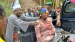 Gov Amosun helping a victim of the accident.