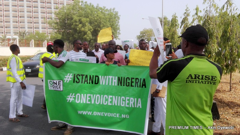 The #iStandwithNigeria protesters marching towards the Presidential Villa in Abuja