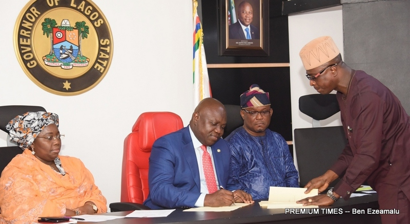 Lagos State Governor, Mr. Akinwunmi Ambode (2nd left); signing into Law the Kidnapping, Sports Trust Fund and Sports Commission Bills at the Conference Room, Lagos House, Ikeja, on Wednesday, February 1, 2017. With him are Deputy Governor, Dr. (Mrs) Oluranti Adebule (left); Majority Leader, Lagos State House of Assembly, Hon. Sanai Agunbiade (2nd right) and  Special  Adviser to the Governor, Office of Civic Engagement, Mr. Kehinde Joseph (right).